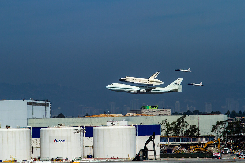 300 ft Fly over.. I was invited by the City of El Segundo to capture the fly by's and final landing of the Space Shuttle Endeavor. Here I have captured her final landing at LAX.
