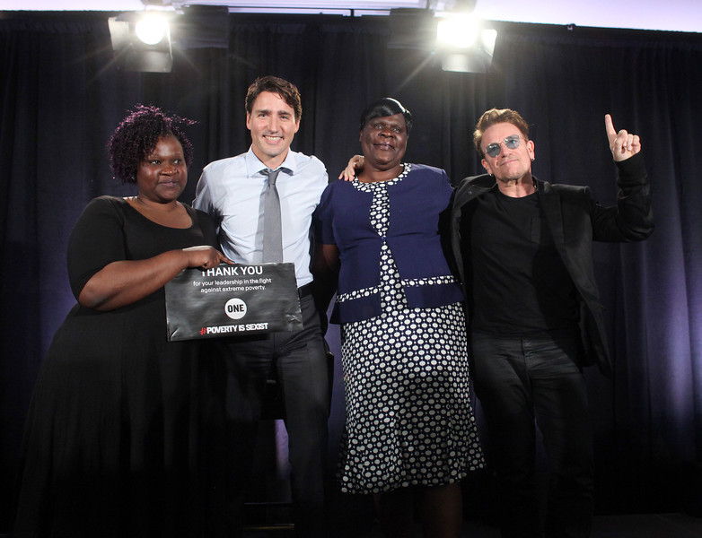 Canada's Prime Minister Justin Trudeau and Bono of U2 makes a presentation during an One.org event in Montreal.