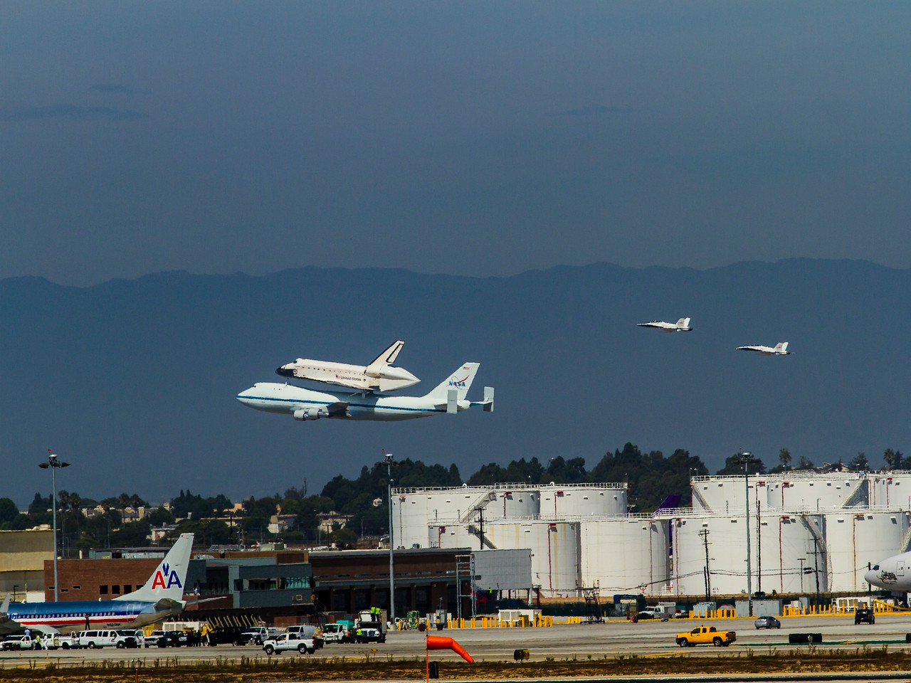 I was invited by the City of El Segundo to capture the fly by's and final landing of the Space Shuttle Endeavor. Here I have captured her final landing at LAX.