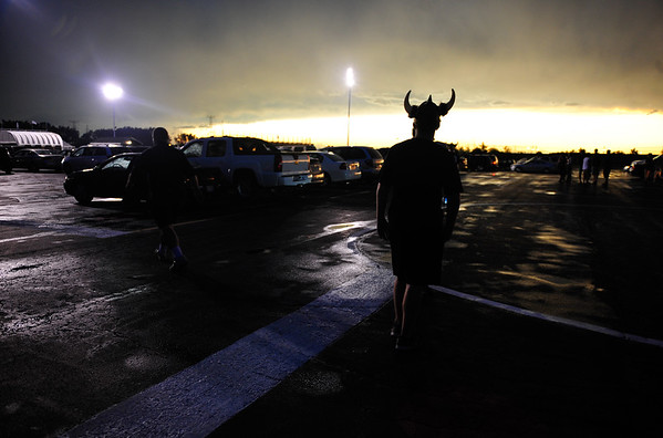 St. Laurence Junior Frank Murry waits in the parking lot at Reavis High School during a lightening delay for the game between Reavis and St. Laurence. The game was eventually cancelled. at Reavis High School, Friday, August 30th, 2013, in Burbank. | Gary Middendorf/For Sun-Times Media