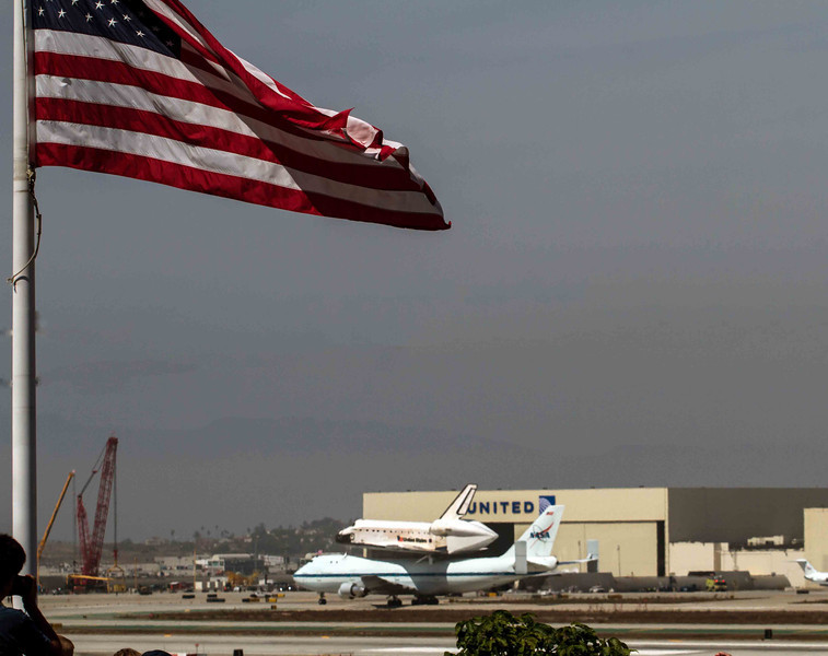 carries the Endeavor to the hanger for the last time after the historical journey to Los Angeles California. I was invited by the City of El Segundo to capture the fly by's and final landing of the Space Shuttle Endeavor. Here I have captured her final landing at LAX.