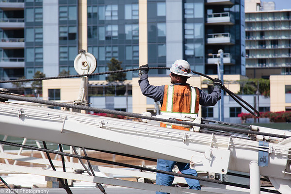 A man builds a crane in downtown San Diego