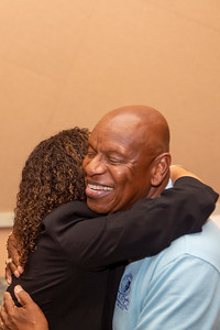 Christina Perez-Burby, a 1994 EOP graduate hugs Charles Jones, Jr., retired Athletic Director and former EOP Director. The 50th Anniversary of CCSU's Educational Opportunity Program kicked off at Alumni Hall in the Student Center with a reception featuring speakers and graduates of EOP on June 29, 2018 in New Britain, CT (image by Johnathon Henninger for CCSU)