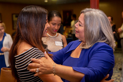 Ely Rodriguez, a 2008 graduate of EOP, left is greeted with a hug by Awilda Reasco, Director, ConnCAP & EOP at the Educational Opportunity Program's 50th Anniversary which kicked off at Alumni Hall in the Student Center with a reception featuring speakers and graduates of EOP on June 29, 2018 in New Britain, CT (image by Johnathon Henninger for CCSU)