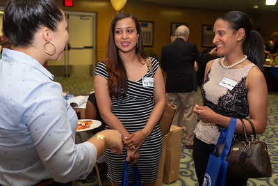 Jatna Nova-Sarfo, a 2007 EOP grad, right smiles while talking with Ely Rodriguez, a 2008 EOP grad, center, and Maricelis Abreu, a Social Work undergrad, left. The 50th Anniversary of CCSU's Educational Opportunity Program kicked off at Alumni Hall in the Student Center with a reception featuring speakers and graduates of EOP on June 29, 2018 in New Britain, CT (image by Johnathon Henninger for CCSU)