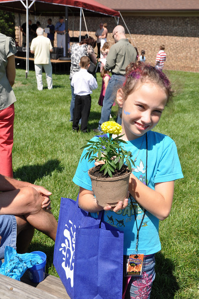 Casey Adams, 9, of Monroe loves her yellow plant that keeps bugs away!