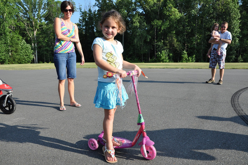 Erin Leo scooting in the Bike Wagon Pet Parade.
