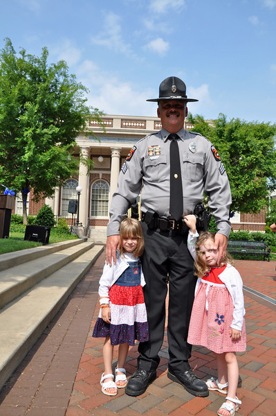 Sgt. Mike Kane, Stallings PD, with 4 yr. old daughters Taryn and Alexa
