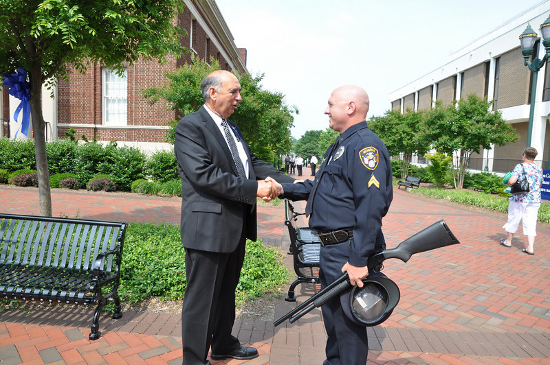City of Monroe Mayor Bobby Kilgore gives appreciation to Monroe Police Department Honor Guard Officer Sherwood.