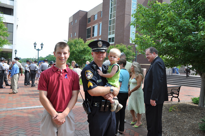 Officer Robert Bartlett with children, Josh, 15 and Dalton,2 of Monroe
