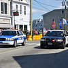 The beginning of the parade, Towns of Groton and Stonington Police leading, Mystic is located in both towns.