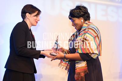 Jennifer Mott handing Monica Garnes her award (M)