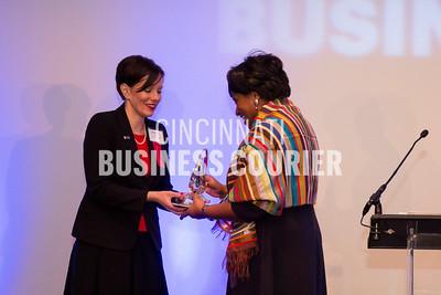 Monica Garnes accepting her award from Jennifer Mott (C)