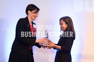 Jennifer Mott (First Financial Bank) handing Janet Fletcher (Proctor and Gamble) her award (M)