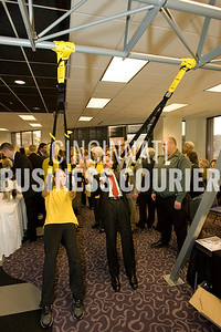 040711_BC_Healthiest Dave Conway, of SqFoot Construction on the right, works out at one of the vendor tables in the Expo Thursday morning at the Healthiest Employers breakfast event. Photo © 2010 Mark Bealer Bealer Photographic Arts (513) 314-5114 mark@bealerphotography.com www.bealerphotography.com