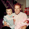 1991-12-24_Kelsey_Mike Pepek_Katherine Wichner.jpg<br /> <br /> Uncle Mike Pepek has his hands full with 15 month old Kelsey and 6 day old Katherine