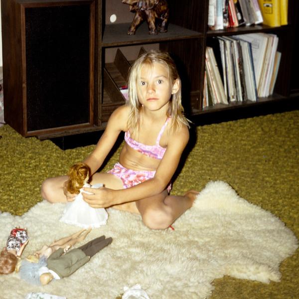 1972-11 Rose Leder.jpg<br /> <br /> Rosie playing with Barbie's at Grandma & Grandpa Wichner's