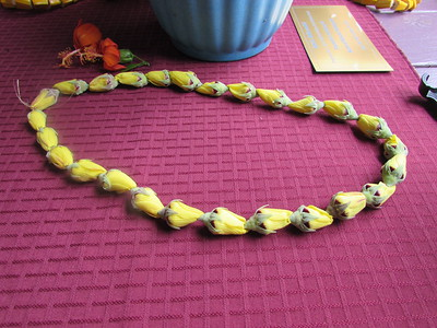 Hau bud lei by Elaine Wender. The buds have to be picked in the afternoon or early evening.