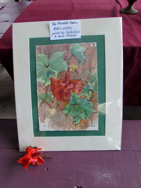 Muffie Davis' painting of Kokia cookei for Richard, along with a real flower. Richard had this painting at home; it will be framed and hung in the office of his former employer, with a descriptive plaque.