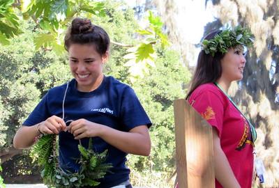Kamehameha Honor Society member volunteers generated interest by making their own lei after helping prepare material.