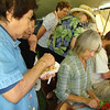 Late morning was the most crowded. Some of the onlookers were waiting for someone to finish so they could make a lei.