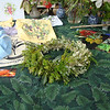 Head lei by Irene Newhouse, using material donated by Lorna Hazen, made at the booth as a lei-making demonstration. Ohia, hao, moa, were used on a twisted ti leaf base.