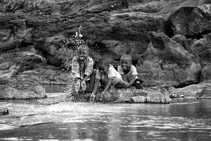 Children playing at a river