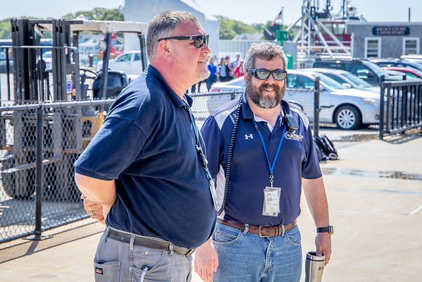 The Kennedy's Capt. Michael Campbell, MMA '87 (rt) makes final plans with MARAD Rep.