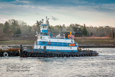 Tug 'Pops' towing alongside