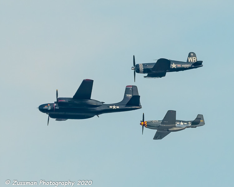 Upper aircraft is a Chance-Vought Corsair, middle aircraft may be a Douglas B-26 Invader, lower aircraft is another P-51D or P-51B since I can't see the canopy.