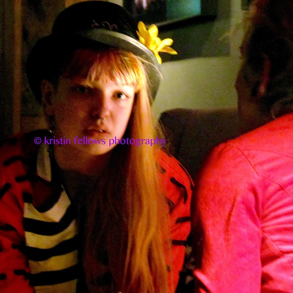 the girl with the yellow flower on her hat