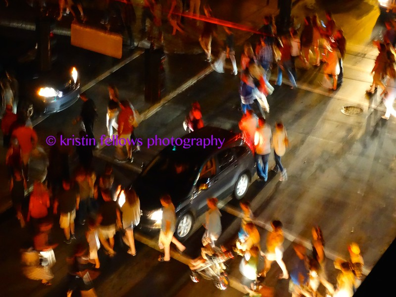 the choreography of the mad rush for cars after the fireworks ~ bathed in the magic of urban street lighting