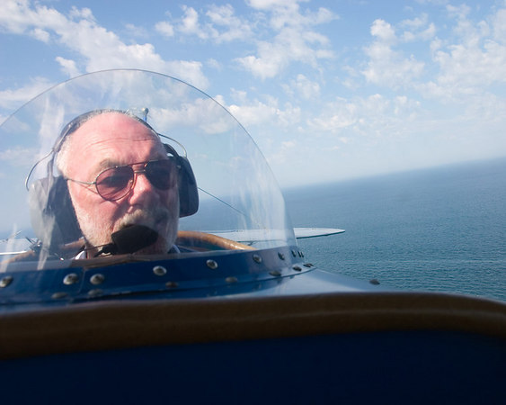 """""""Backseat Driver""""<br /> (taken from the front seat of a 1927 bi-plane)<br /> <br /> Winner, 2nd Place<br /> Special Category: Airplanes<br /> Wallingford Camera Club<br /> September 13, 2006"""
