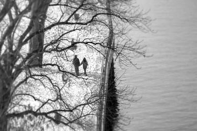 Couple Walking Along the River