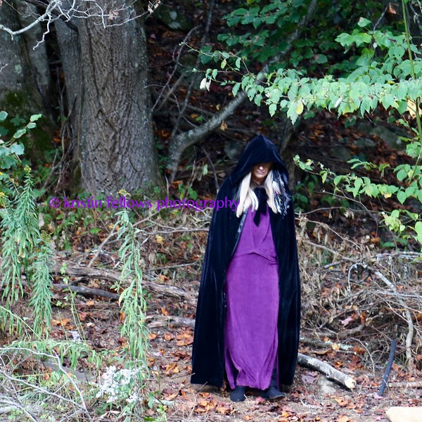 the high priestess appears from the forest