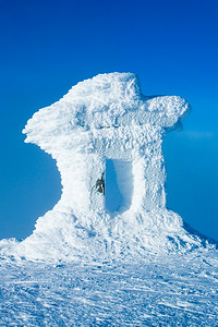 Frozen Inukshuk on the peak of Whistler mountain