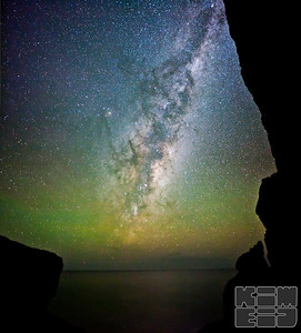 The milky way shot thru 'Whitewater Wall' in Freycinet National Park, Tasmania, Australia