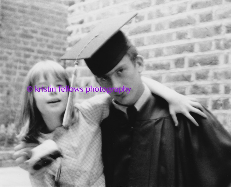 kristin with pip in his hs graduation gown