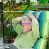 mom relaxing on the back deck