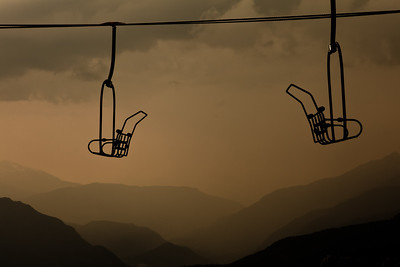 Looking north thru a chair lift at an approaching storm