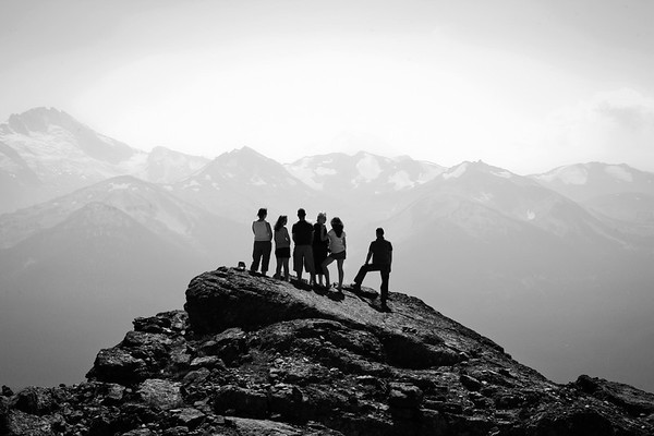 A family takes in the scenery on Whistler mountain
