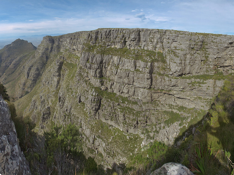 When taking this pano I almost fell off table mountain - the next stop would have been about 700 meters down. See the shadow in the lower right corner? That's the guide grabbing me...