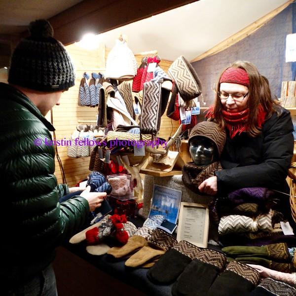 trying on reindeer skin gloves