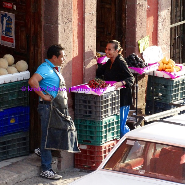 morning vendors greet one another