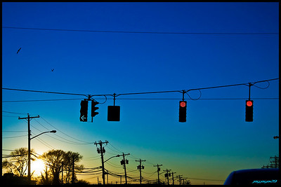 Intersection someplace on Long Island. Purposely over-colorized to provide an interesting gradient through the picture, also brings focus to the traffic lights, electrical lines and birds.