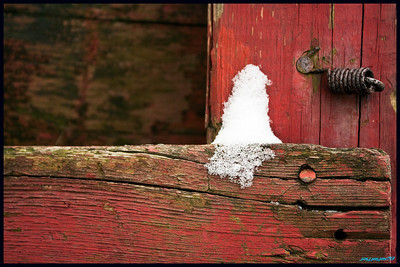 Little bit of snow sitting on fence near my house. Composition, color, and detail were key with this shot.