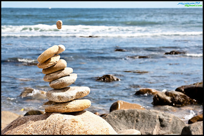 Rock collection at Montauk Point, Long Island. Rule of thirds (almost) composure, subject is nicely separated from background due to zoom blur.