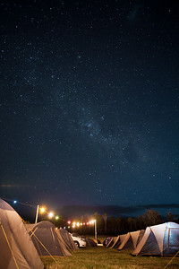 The milky way above a campground at Falls festival, Tasmania