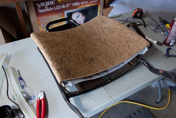 Passenger seat back, cushion in place