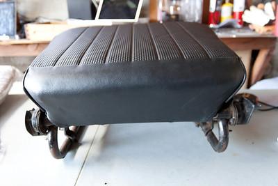 Passenger seat bottom, covered